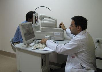 Dr. Daraius Shroff examining a patient